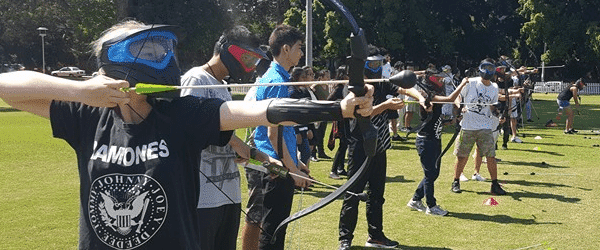 Line of archers playing Arrow Tag